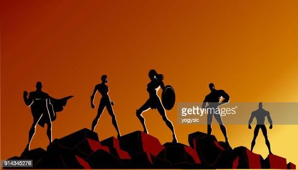 vector superhero team silhouette on rocks - battle stock illustrations