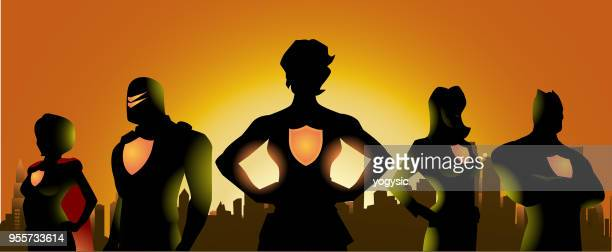 vector superhero team silhouette with woman leader and city skyline background - back lit stock illustrations