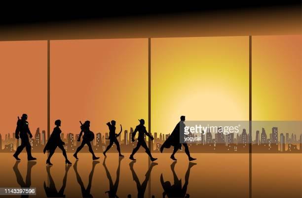 bildbanksillustrationer, clip art samt tecknat material och ikoner med vektor superhjälte team walking i en hall med stadssilhuetten bakgrund - gala tilldragelse som firas