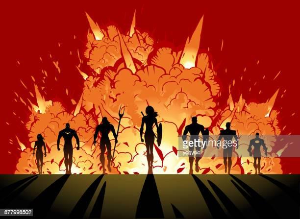 vector superhero team wth female leader silhouette walking away from explosion - team captain stock illustrations