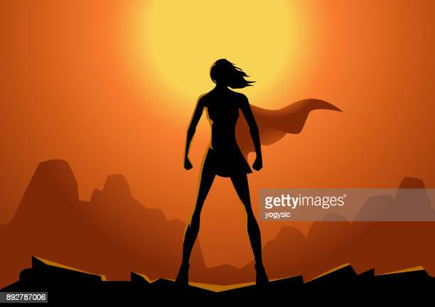 vector superhero woman silhouette with sun in the background - females stock illustrations