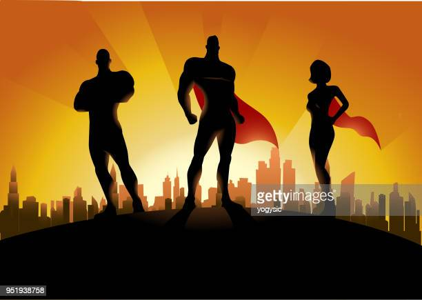 vector trio superhero team silhouette with city skyline in the background - heroes stock illustrations
