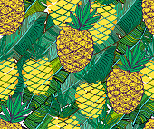 Vector tropical pattern. Fresh ripe pineapples and palm leaves. Hand drawn seamless background.