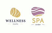 Vector wellness and spa center symbol with abstract stylized stone isolated on white background.