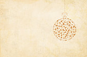 Vector Xmas background. Beige vintage paper with a suspended christmas bauble to the right in the frame. The bauble is hanging by a ribbon tied into a bow on the top.