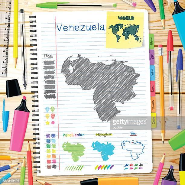 Venezuela maps hand drawn on notebook. Wooden Background
