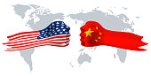 USA versus China, fist flag on world map background.