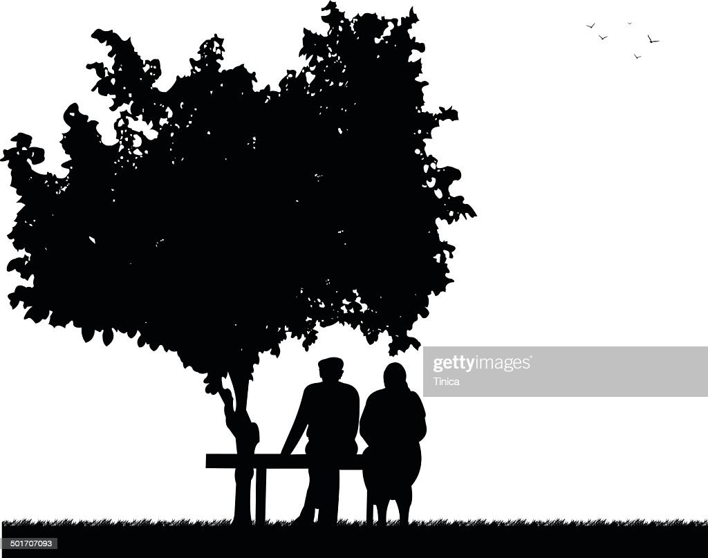 Very old couple sitting on bench in park
