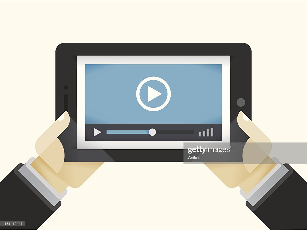Video player on Tablet Computer in internet user hands