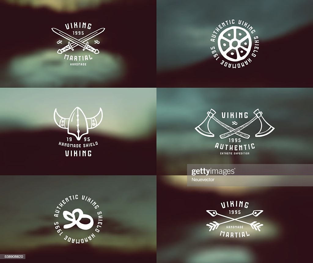 Viking emblems in hand-drawn style and blurred background landsc