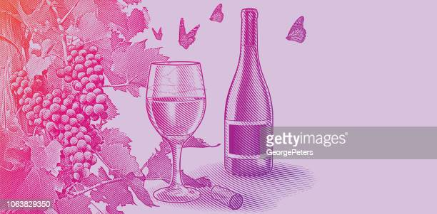 Vineyard wine grapes with bottle and glass of wine