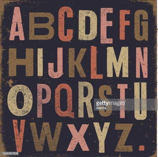 vintage alphabet dunklen hintergrund - abc stock-grafiken, -clipart, -cartoons und -symbole
