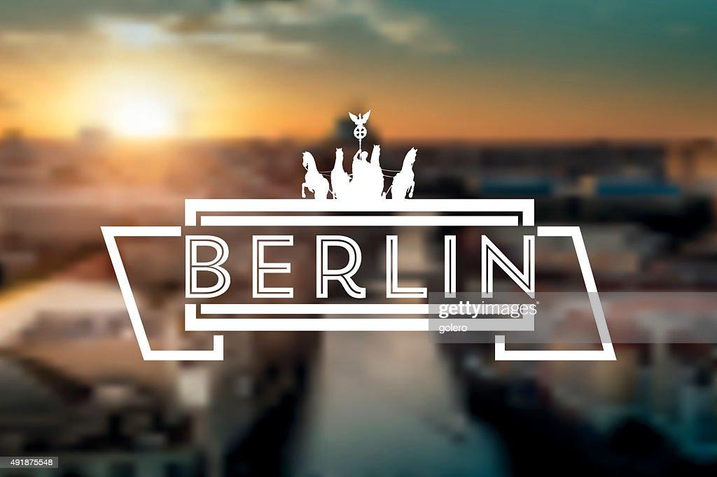 vintage berlin sign on blurred sunset skyline