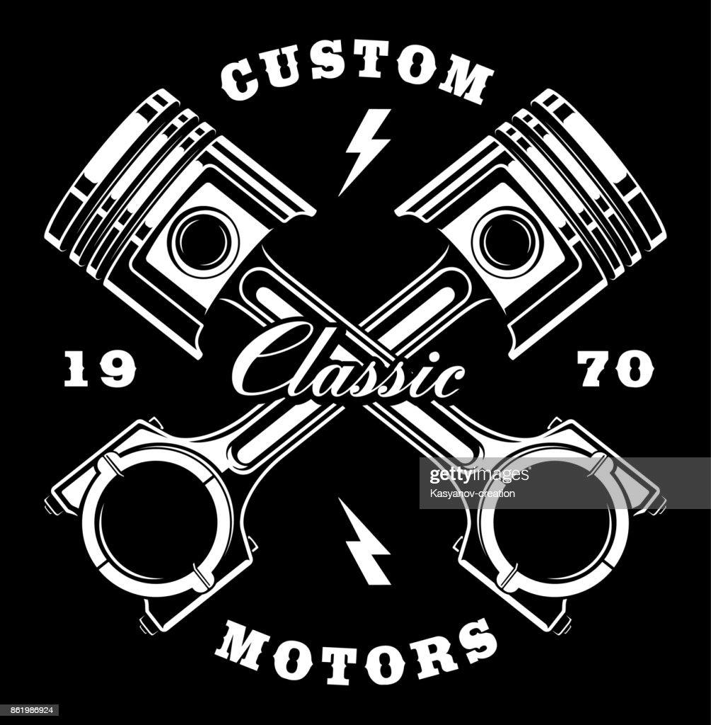 Vintage crossed pistons on dark background