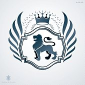 Vintage decorative heraldic vector emblem composed with wild lion illustration and royal crown