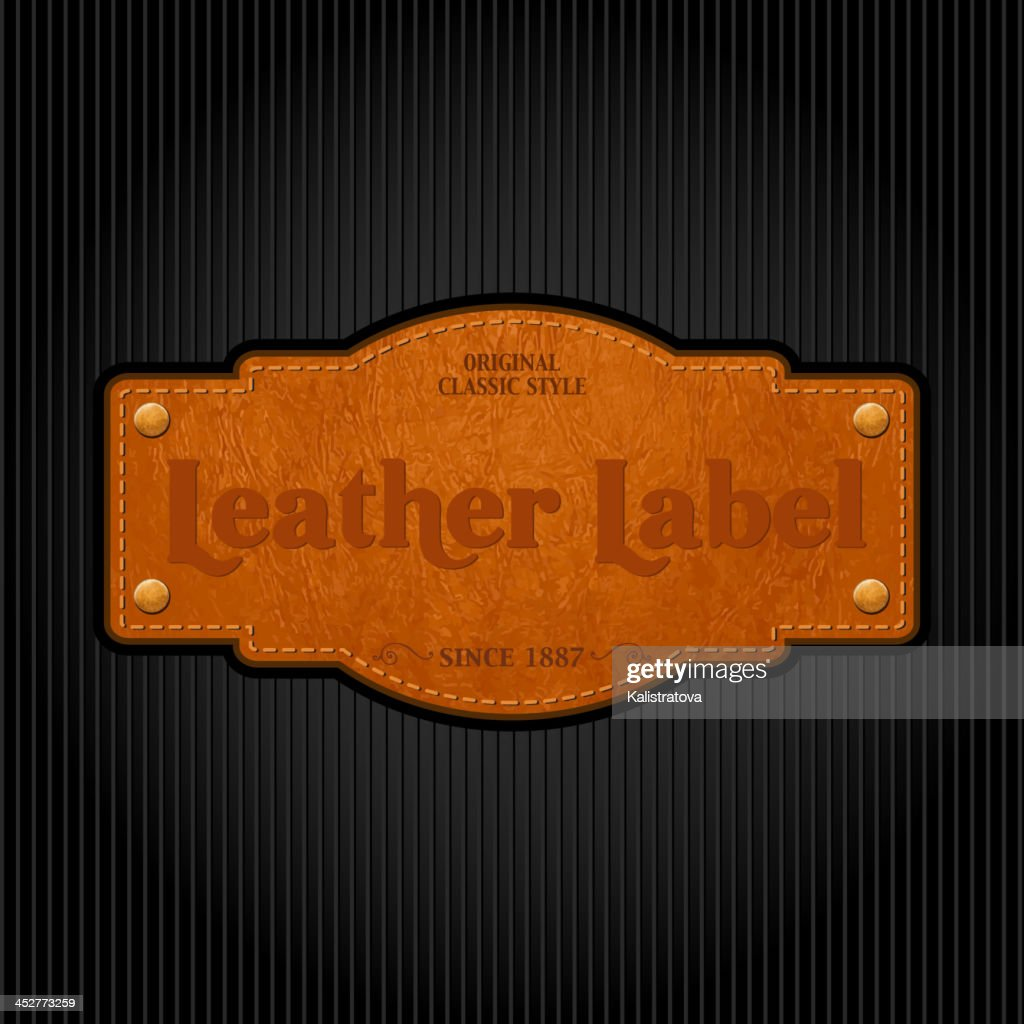 Vintage leather label attached to a pinstripe background