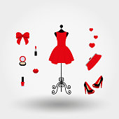 Vintage mannequin in a red dress, high heels, clutch bag, powder, lipstick, nail polish.