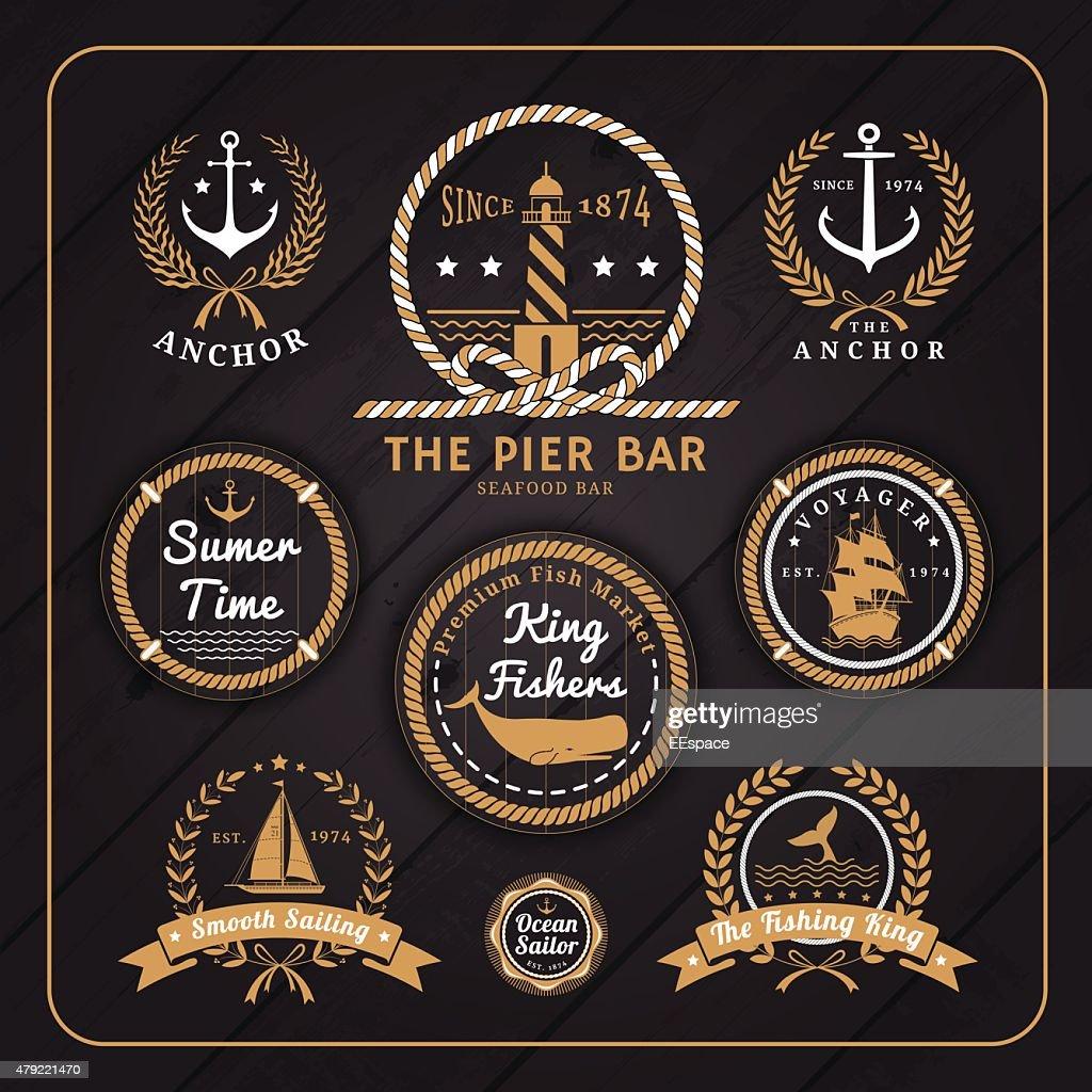 Vintage nautical labels set on dark wood background