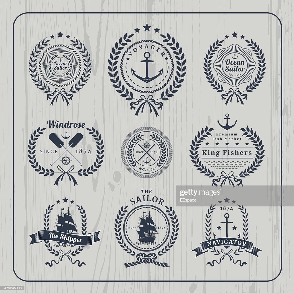 Vintage nautical wreath labels set on light wood background
