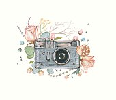 Vintage retro photo camera in flowers.