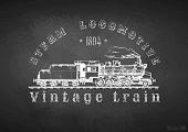 Vintage train on blackboard