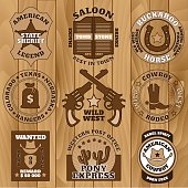 Vintage wild west badges on wooden background