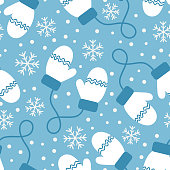 Vintage winter seamless pattern with mittens and snowflakes on blue background.
