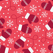 Vintage winter seamless pattern with mittens and snowflakes on red background.
