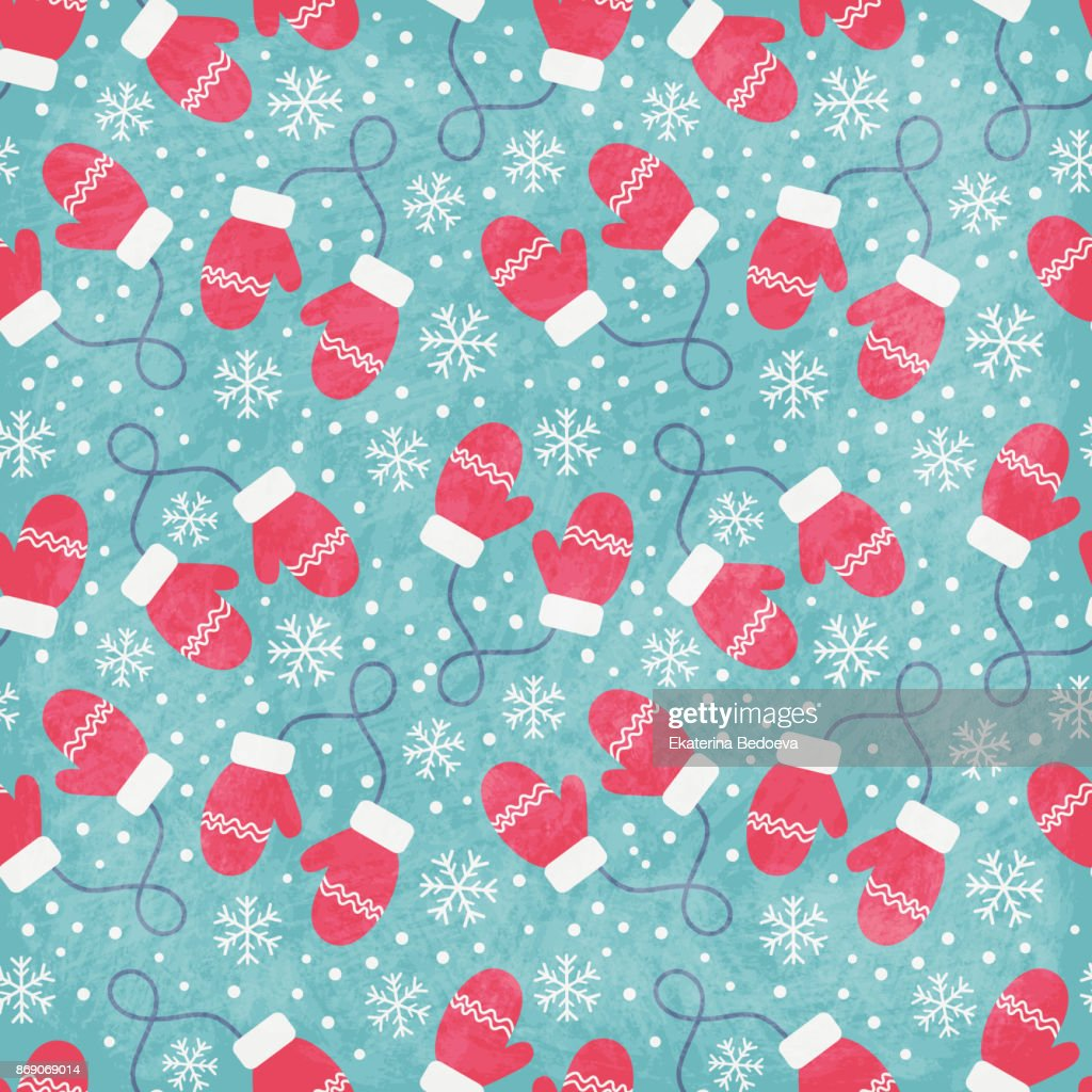 Vintage winter seamless pattern with red mittens and snowflakes on blue background.