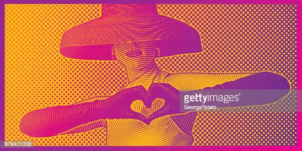 Vintage Frau machen Herzschild mit Händen