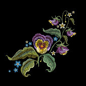 Violets flower embroidery. Classical embroidery beautiful summer flowers violet on black background t-shirt design,template fashionable clothes
