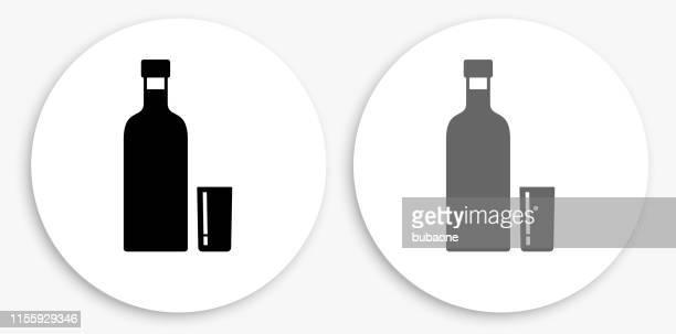 vodka shot black and white round icon - vodka drink stock illustrations, clip art, cartoons, & icons