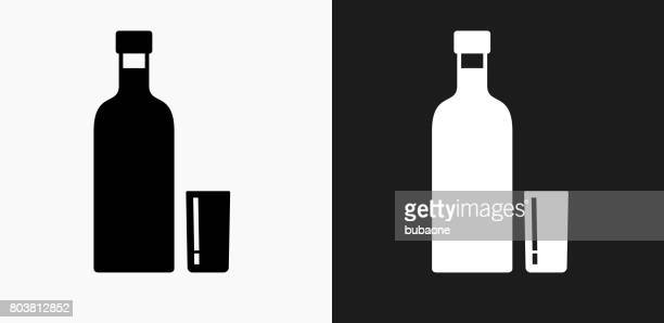 vodka shot icon on black and white vector backgrounds - shot glass stock illustrations, clip art, cartoons, & icons