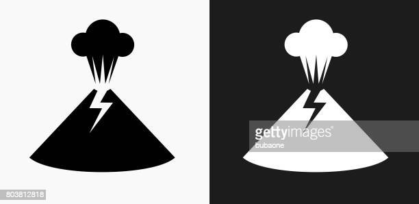 volcano eruption icon on black and white vector backgrounds - volcano stock illustrations, clip art, cartoons, & icons