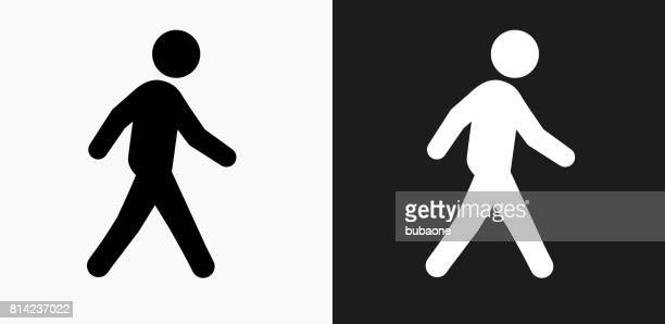 walking icon on black and white vector backgrounds - pedestrian stock illustrations, clip art, cartoons, & icons