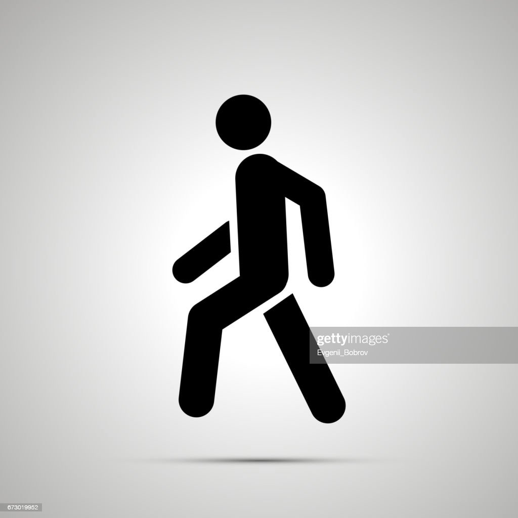 Walking man simple black icon with shadow