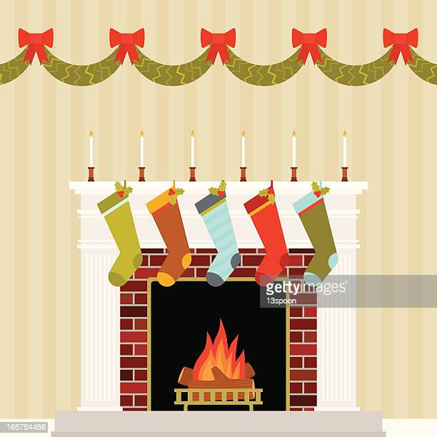 warm and festive christmas mantle - christmas stocking stock illustrations