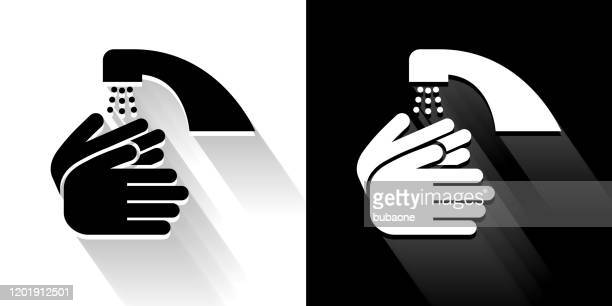 washing hands  black and white icon with long shadow - washing hands stock illustrations