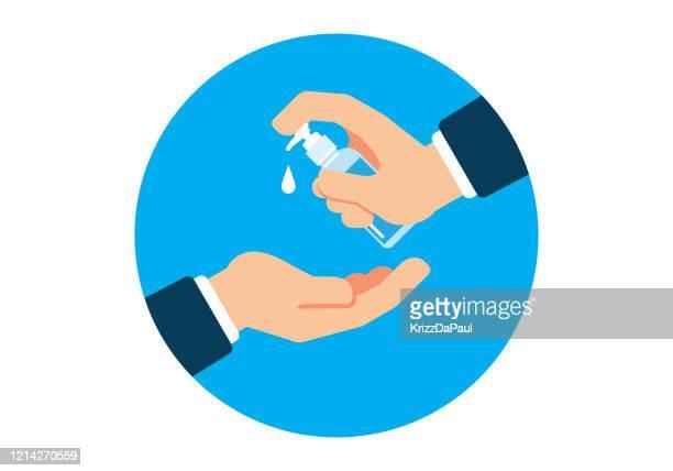 washing hands - rubbing alcohol stock illustrations