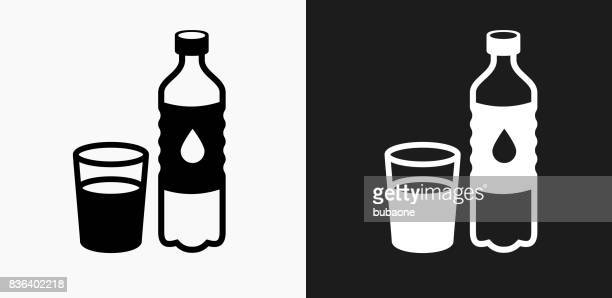 water bottle and glass icon on black and white vector backgrounds - water bottle stock illustrations, clip art, cartoons, & icons