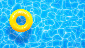 Water pool summer background with yellow pool float ring. Summer blue aqua textured background