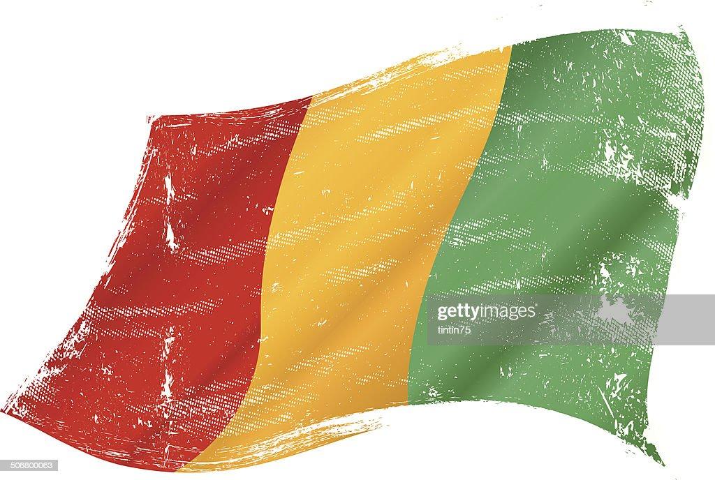 waving Guinean grunge flag