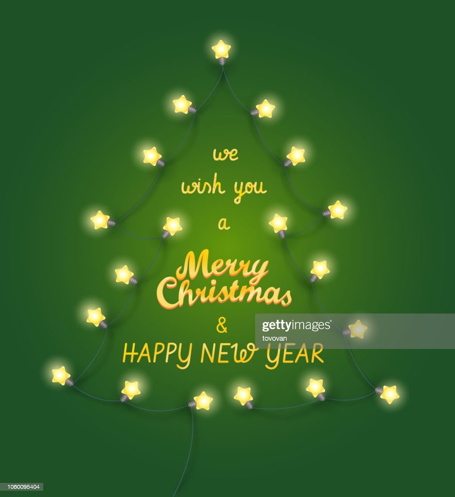 We wish you a Merry Christmas and Happy new Year. Abstract Christmas tree made from lighting garland