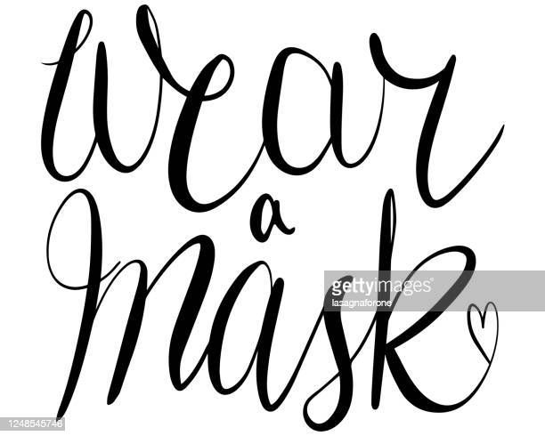 wear a mask - hand lettered modern calligraphy vector - non western script stock illustrations