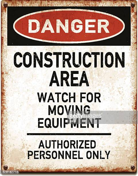 Weathered metallic placard with danger construction area warning_vector