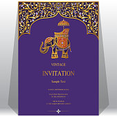 Wedding Invitation card templates with gold Elephant patterned and crystals on paper color Background.