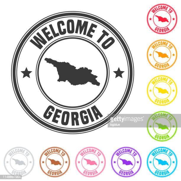 ilustraciones, imágenes clip art, dibujos animados e iconos de stock de bienvenido a georgia sello-insignias coloridas sobre fondo blanco - georgia estado de eeuu