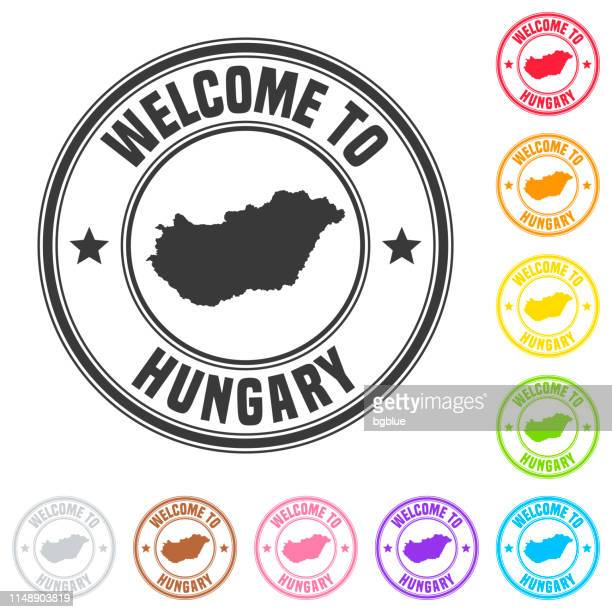 Welcome to Hungary stamp - Colorful badges on white background