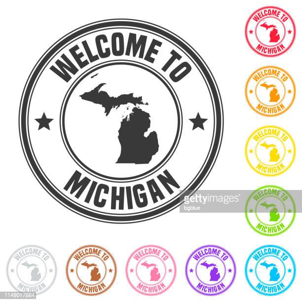 welcome to michigan stamp - colorful badges on white background - detroit michigan map stock illustrations
