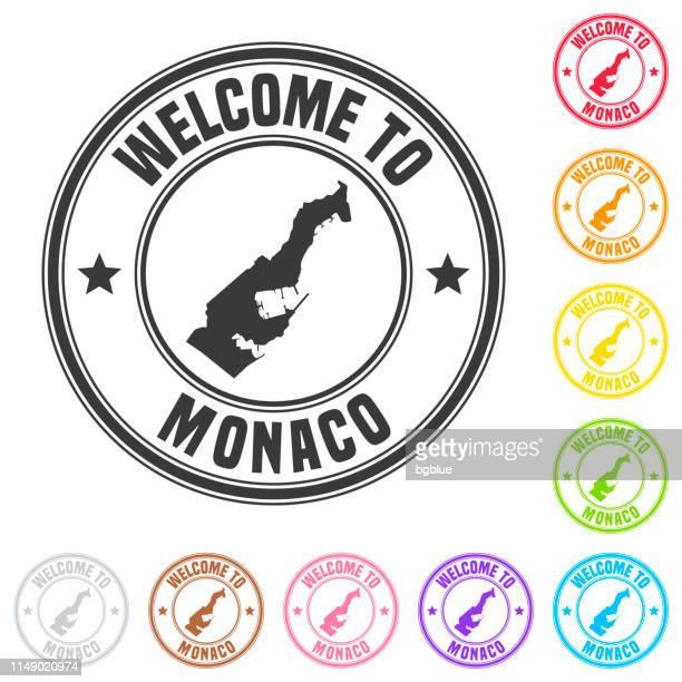 willkommen in monaco-marke-bunte abzeichen auf weißem hintergrund - monaco stock-grafiken, -clipart, -cartoons und -symbole